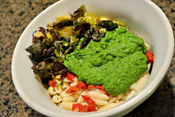 kale pesto cavatelli with crispy brussels and sundried tomatoes