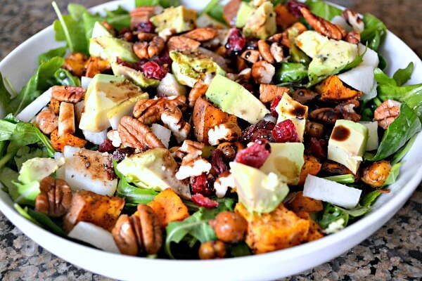 Salad with arugula, spinach, leftover roasted chickpeas and sweet potatoes, radishes, dried cranberries, pecans and avocado