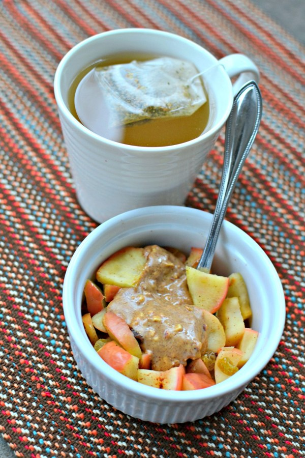Microwave baked apples with raisins, cinnamon and almond butter
