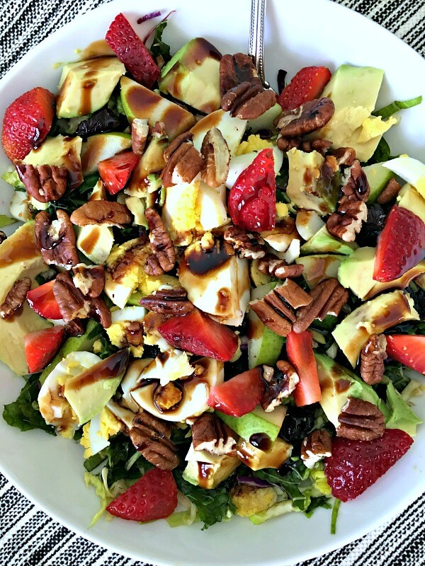 Trader Joe's Cruciferous Crunch massaged with olive oil, sea salt and lemon juice, strawberries, pears, toasted pecans, avocado, hardboiled egg and dried cherries with balsamic.