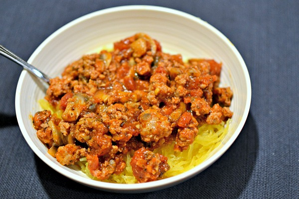Spaghetti squash with sauteed Italian sausage, Whole Foods Organic Tomato & Herb marinara sauce and mushrooms.