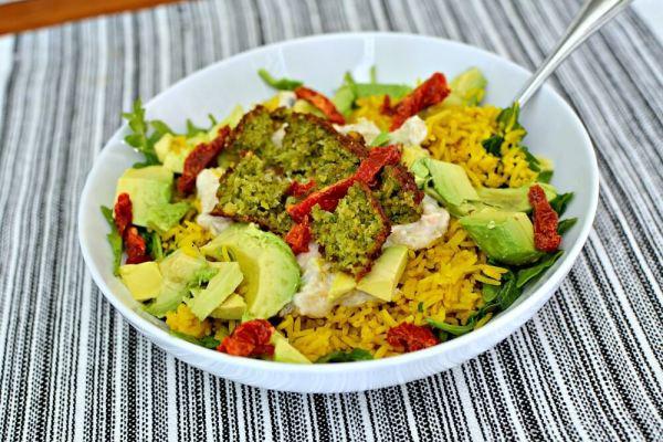 Arugula, rice, babaganoush, avocado, falafel and sundried tomatoes.