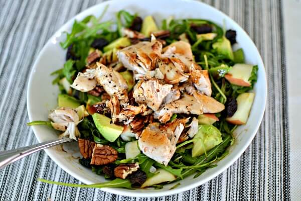 Salad with arugula, lemon pepper seasoned chicken tenders, apples, avocado, dried unsweetened cherries and toasted pecans
