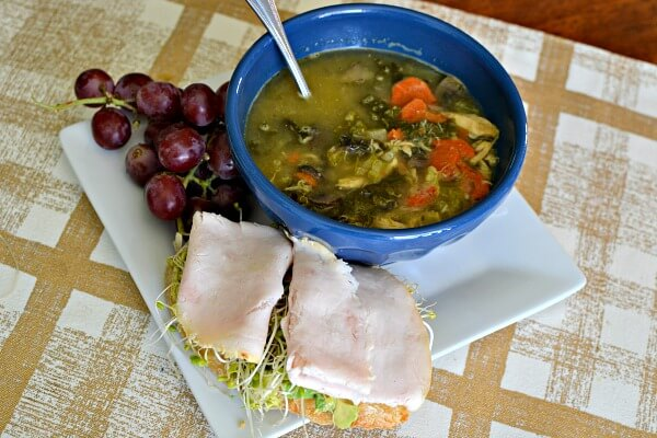 Lemony Chicken and Kale Soup with avocado toast topped with sprouts and turkey.