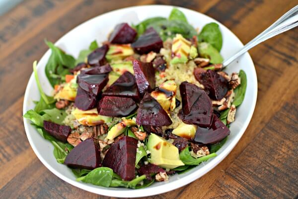 Spinach, leftover couscous from a dinner you'll see below, roasted beets, avocado, toasted pecans and dried cranberries. Dressed with olive oil and balsamic.