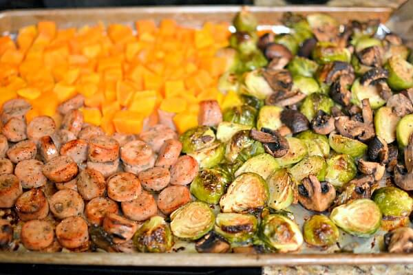 One pan roasted dinner with chicken apple sausage, butternut squash, brussels sprouts and baby portobello mushrooms