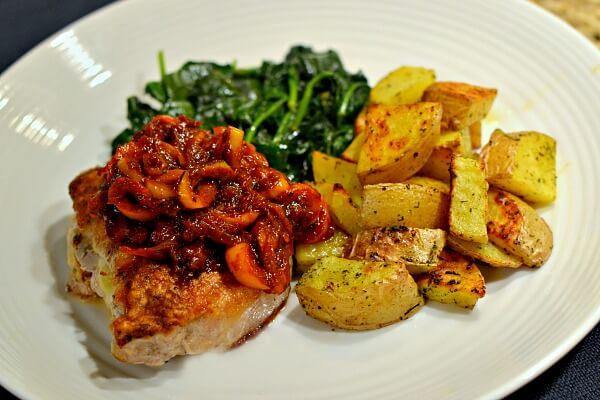fontina stuffed pork chop with roasted potatoes and a pizzaiola sauce