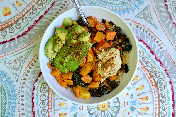 Lunch bowl with quinoa, sauteed kale and kimchi, roasted butternut squash, avocado, Cedar's lemon cayenne hummus, coconut aminos and Be Runa seed salt.
