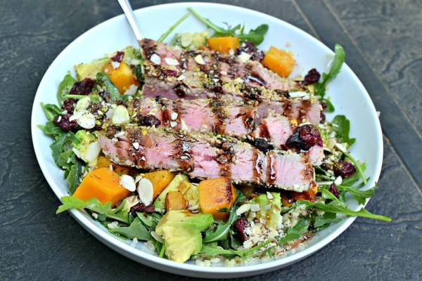 Arugula tossed with quinoa, olive oil, sea salt and lemon juice and then topped with butternut squash, avocado, dried cranberries, sliced avocados and the last of the sesame crusted tuna. Aged balsamic to finish it off.