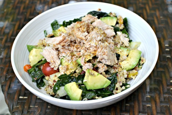 kale and super grain salad with salmon and avocado
