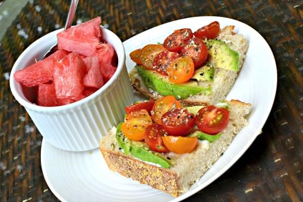 open faced tomato and avocado sandwich