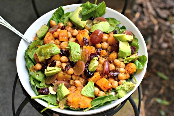 Salad with spinach, avocado, dried cranberries, grapes and avocado. I also sauteed chickpeas and butternut squash in a cast iron pan with some seasonings and added them warm on top.