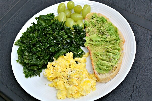 Massaged kale, grapes, avocado toast and scrambled eggs.