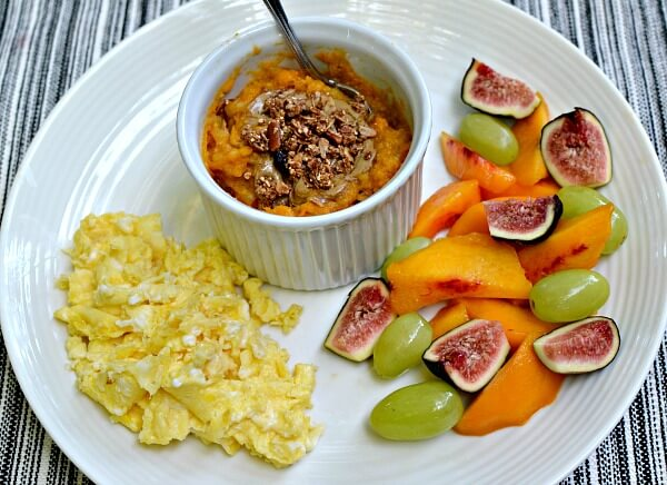 Scrambled eggs, fruit and a sweet potato breakfast bowl.