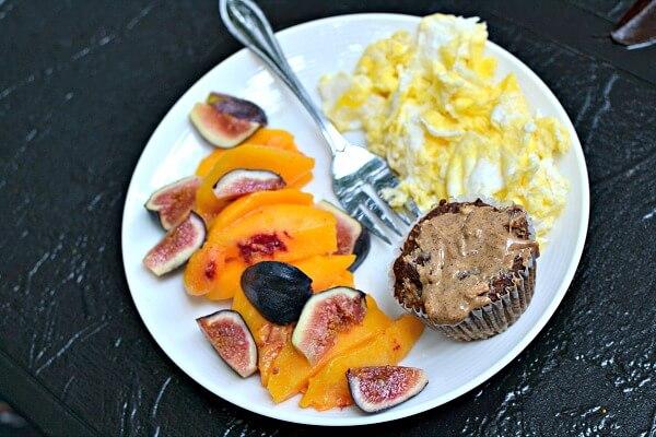 Paleo banana bread muffin, fruit and scrambled eggs.