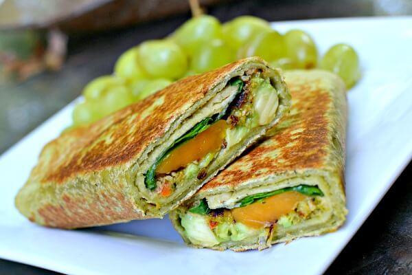 Cedar's spinach wrap with a Dr. Praeger's California veggie burger, cheddar cheese, avocado hummus, avocado and arugula.