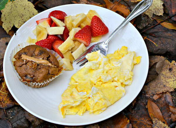 Two eggs scrambled in salted Kerrygold butter, a pumpkin date muffin with Wild Friends peanut cashew super butter and fruit.