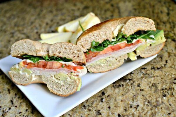 ham, turkey and avocado bagel sandwich