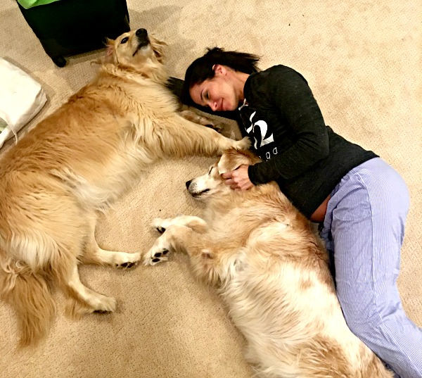 Cuddling with dogs