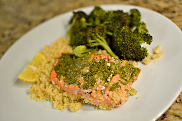 pesto baked salmon over couscous with broccoli