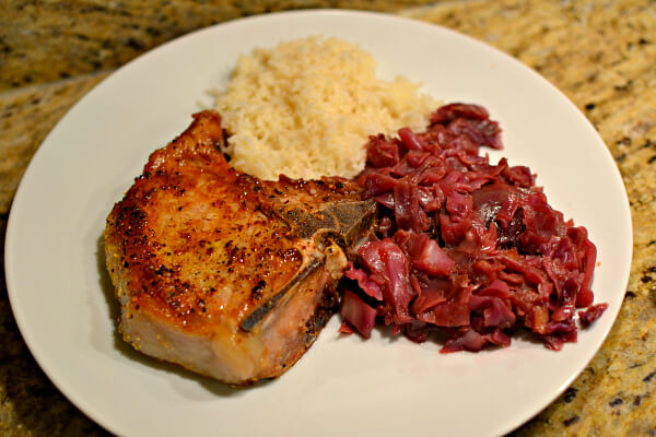 cast-iron seared pork chop with red cabbage and rice