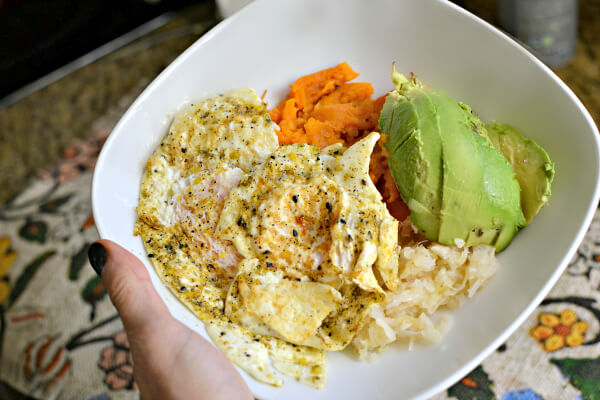 mashed sweet potatoes, sauerkraut, avocado and fried eggs