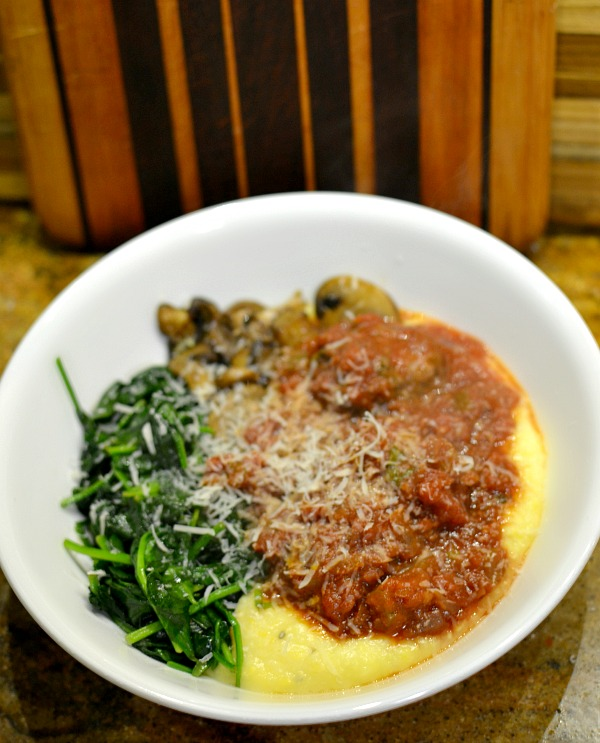 Meatball marinara over polenta with sautéed spinach and mushrooms