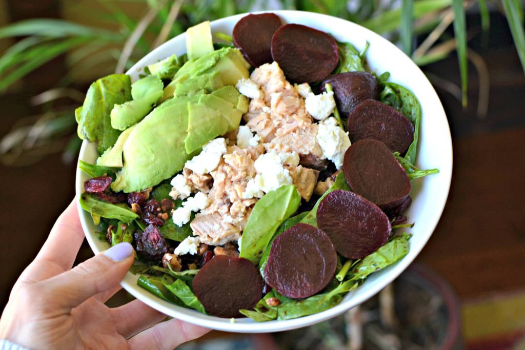 salad topped with blue harbor salmon