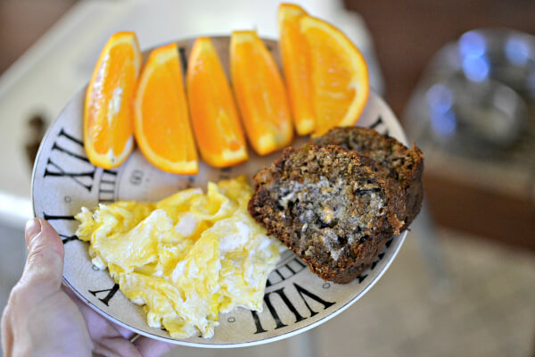Buttered banana oat bread, scrambled eggs and orange slices