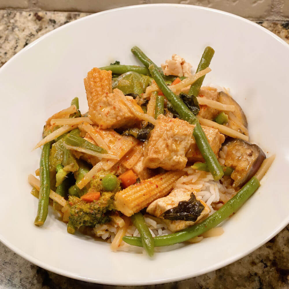 red coconut curry with tofu and vegetables
