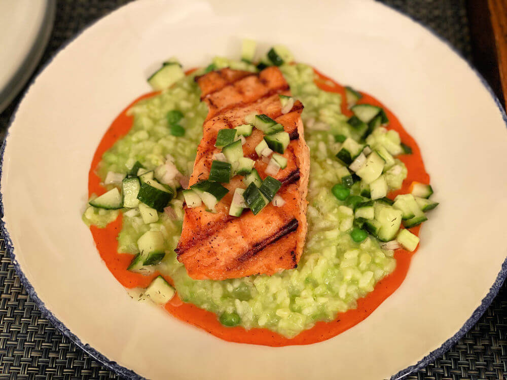 salmon over herb and pea risotto