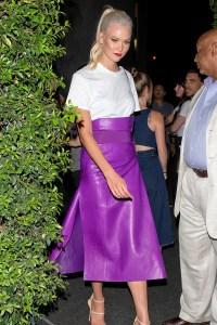 celebrity wearing violet skirt