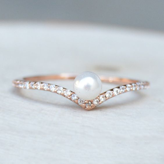 pearl engagement ring with tiny diamonds