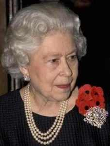 queen elizabeth II wearing a triple strand pearl necklace