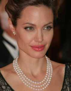 Angelina Jolie wearing a three strand pearl necklace