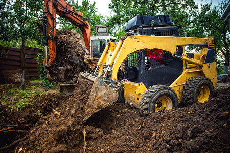 Picture of bulldozer moving earth, site excavation.