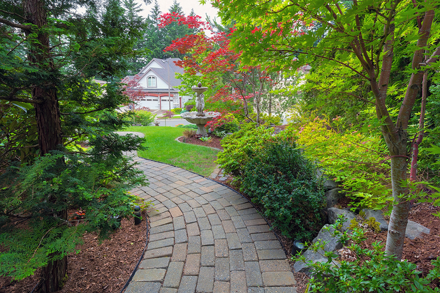 Picture of stone paver pathway through a garden.