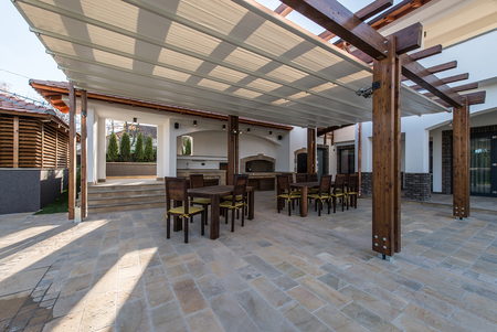 Picture of Beautiful terrace lounge with pergola and wooden table with chairs