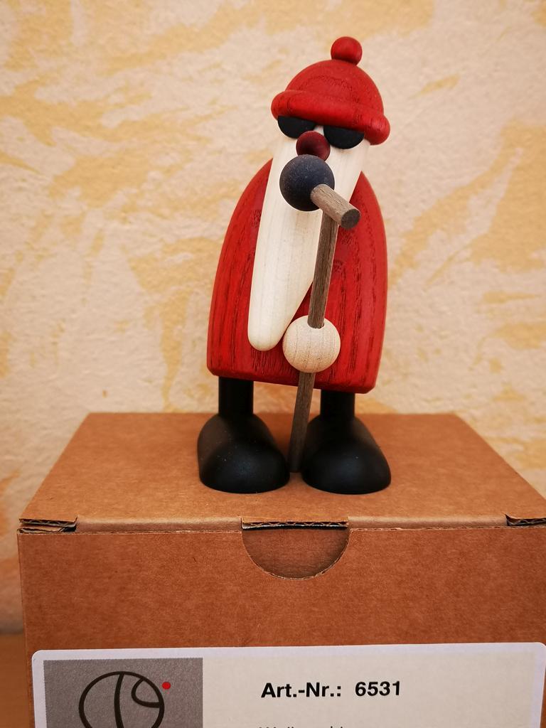 Weihnachtsmann mit Mikrophon