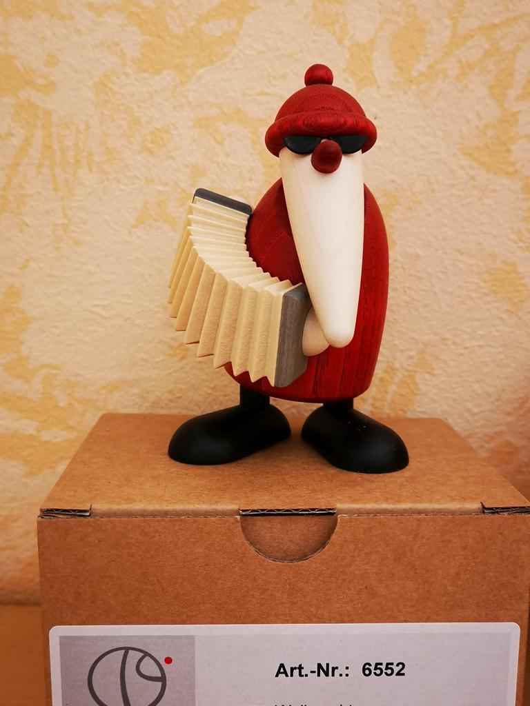 Weihnachtsmann mit Akkordeon