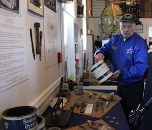 Gene Austin gives visitors a tour of the oyster exhibit
