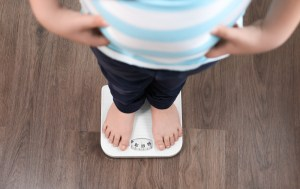 boy standing on a foot scale