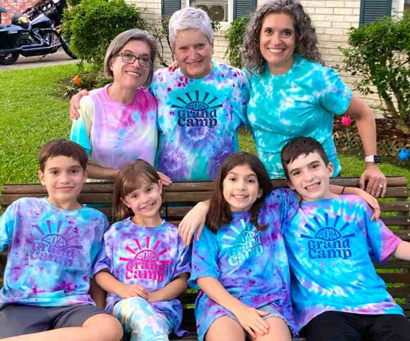 Happy family with tie dyed shirts