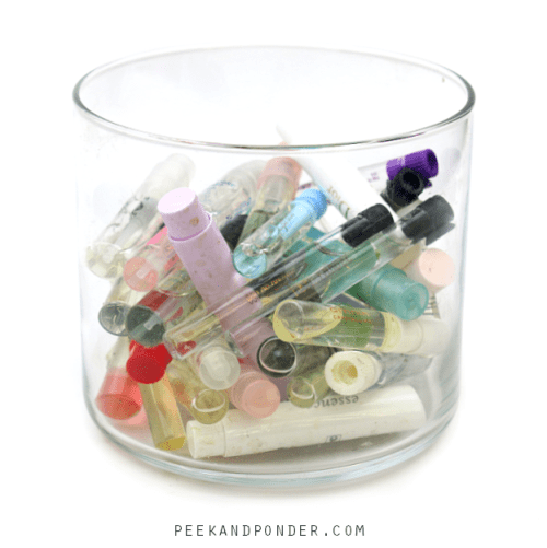perfume samples stored in candle jar