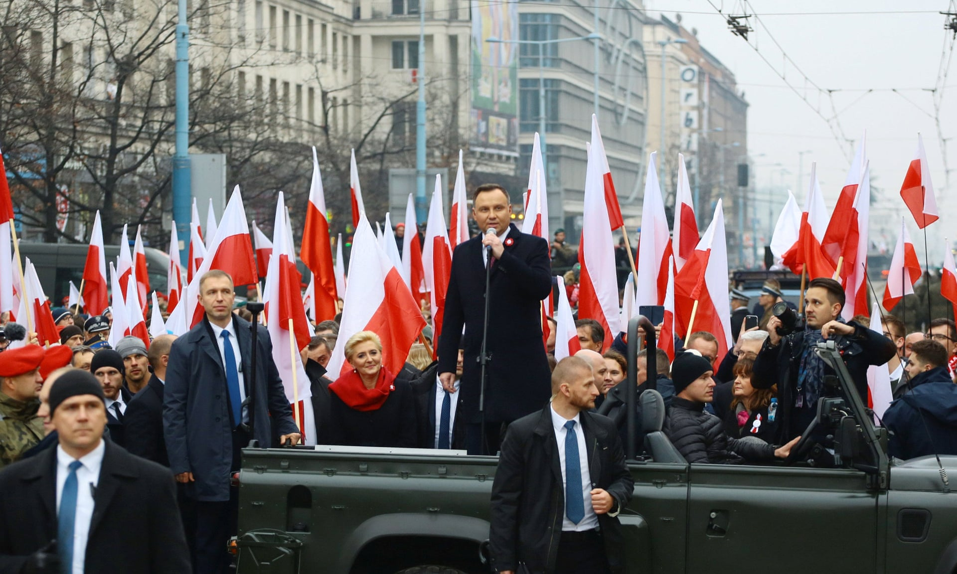 Poland's president, Andrzej Duda, addresses the crowds before the official start of a march marking the 100th anniversary of Polish independence in Warsaw on 11 November.