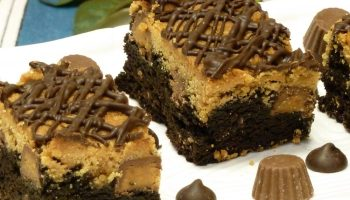 Yummy brownies loaded with a peanut butter layer, peanut butter cups, and chocolate chips.