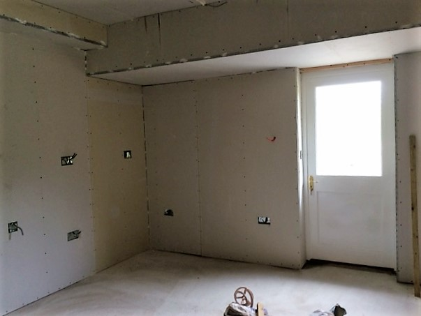 Kitchen, boarded, ready for plastering