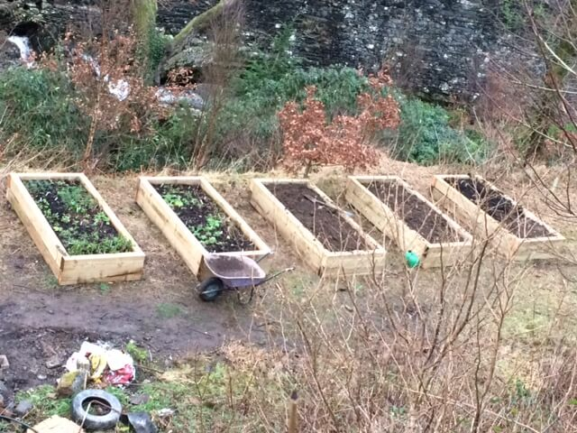 And the beds are now filled with topsoil that previously lived where the labyrinth now stands