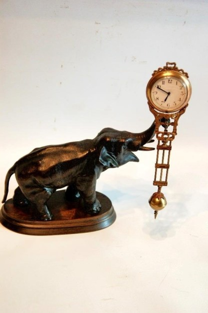 swinging elephant clock