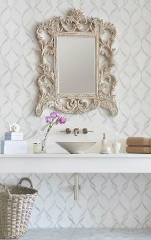 I love the mix of a modern graphic wall paper and simple, clean vanity with such an ornate mirror. This is shabby chic done just the way I like it!